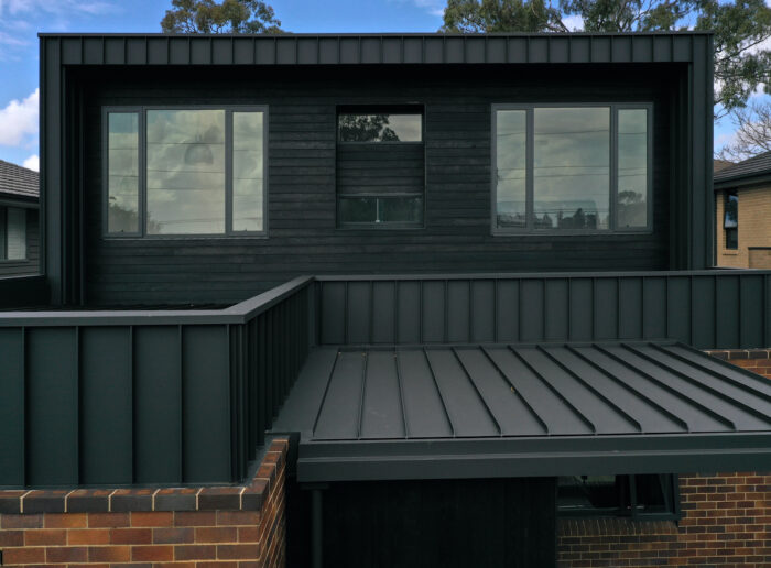 Strongly Contoured Vertical Ribs Compliment Gladesville Home Perfectly